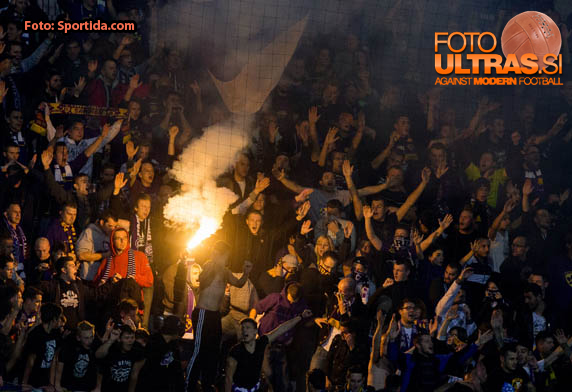 Supporters of Maribor celebrate after penalty shot during football match between NK Maribor, SLO  and Chelsea FC, ENG in Group G of Group Stage of UEFA Champions League 2014/15, on November 5, 2014 in Stadium Ljudski vrt, Maribor, Slovenia. Photo by Vid Ponikvar / Sportida
