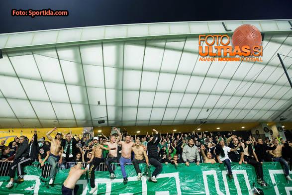Green Dragons, fans of Olimpija during football match between NK Maribor and NK Olimpija Ljubljana in 12th Round of Prva liga Telekom Slovenije 2014/15, on October 4, 2014 in Stadium Ljudski vrt, Maribor, Slovenia. Photo by Vid Ponikvar / Sportida.com